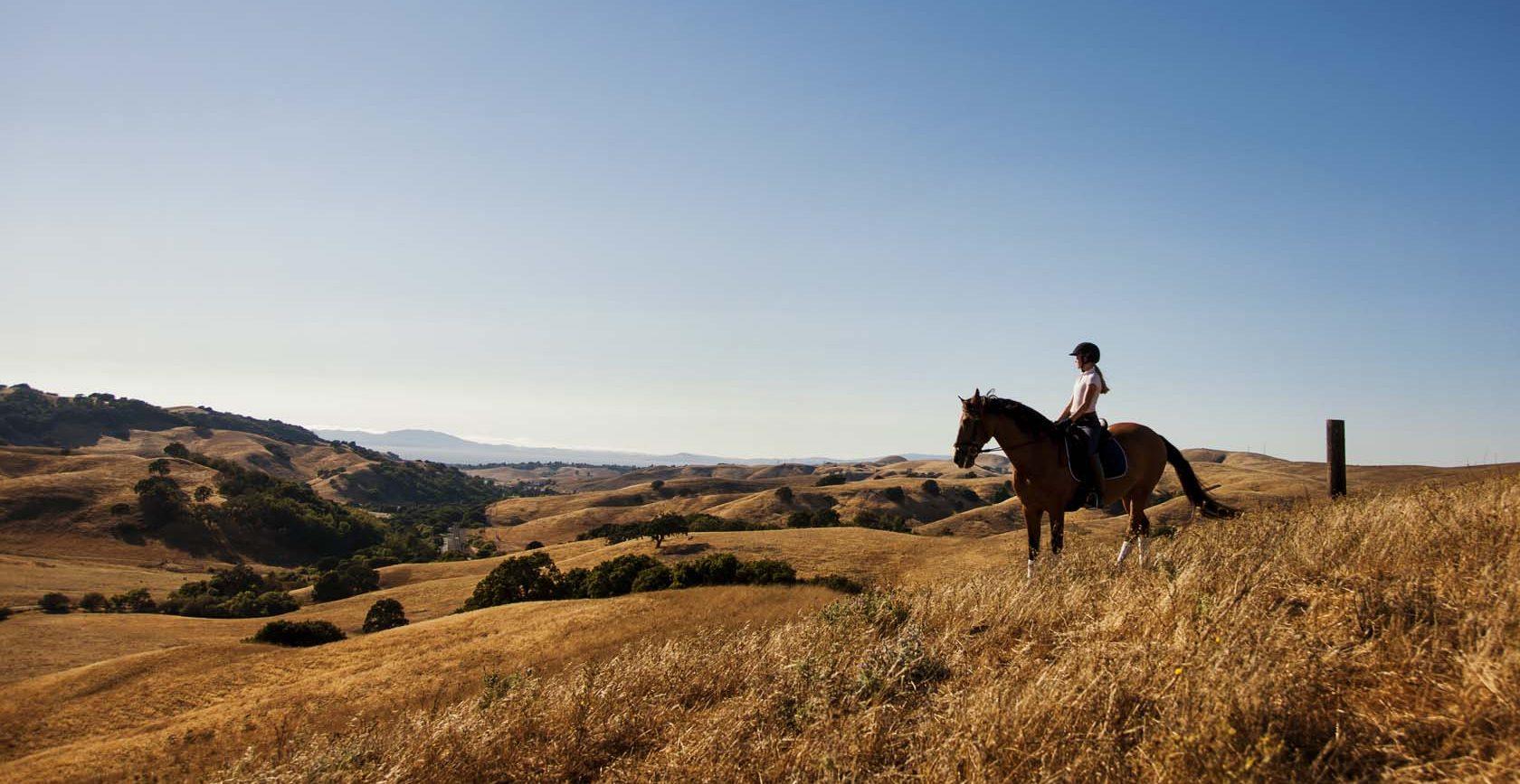 A woman on horseback explores the views of Sky Ranch